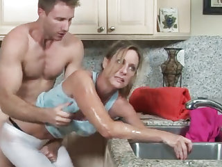 MILF gets her hand stuck in the drain, her laddie helps