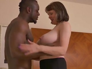 Big-Chested mature Freulein takes a immense dark-hued jizz-shotgun