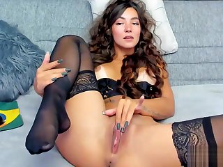 Sexy Brunette Slowly Fingers Her Delicate Pussy On Cam