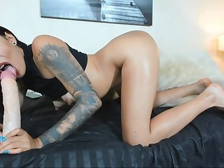 Gorgeous Latina camwhore rides and sucks giant dildo