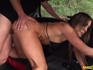Seductive show-off Aubrey Black does the victory in the surrounding of a cab